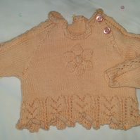 Hand knitted pretty peach jumper