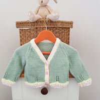 Pale Green Baby Cardigan with pink and yellow  lace edging 6-12 months