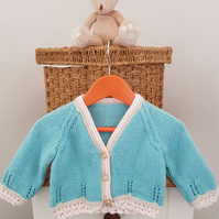 Turquoise Baby Cardigan with cream and pink lace edging 6-12 months