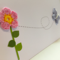 Cute crochet flower with butterfly