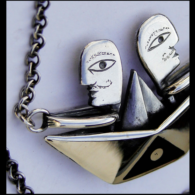 Ginos in the boat, silver and wood pendant.