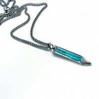 Small Pencil pendant, in silver with turquoise resin.