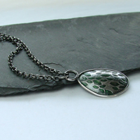 Green leaves pendant in silver with green resin highlights