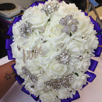 purple and white ivory rose  teardrop brooch wedding bouquet.