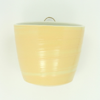 Pastel yellow wall-hung garden pot