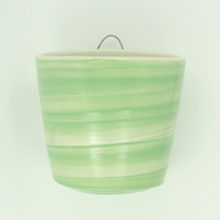 Pastel green wall-hung garden pot