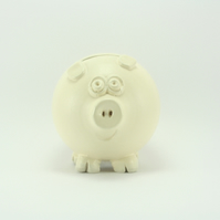 Pastel yellow piggy bank