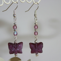 Purple butterfly dangle earrings