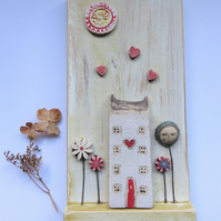 Mixed media artwork assemblage The Flower has a Pretty Home