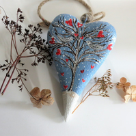 Wooden folk heart winter love birds