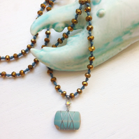 Long gold and blue sea pottery sparkly beach necklace