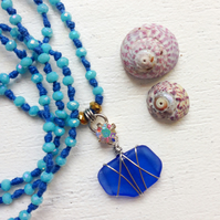 Beautiful cornflower blue long sea glass beach necklace