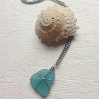 Light turquoise sea glass star necklace