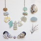 Statement sea glass and pottery necklace in pastel hues