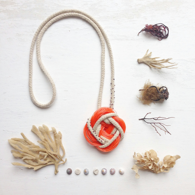 Orange sea plastic, organic hemp and black pearl celtic knot necklace