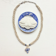 Inky blue flower sea pottery and organic hemp rope necklace