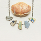 5 stone sea pottery necklace flowers and waves