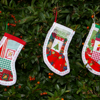 Trio of Christmas stocking decorations in patchwork and cross stitch