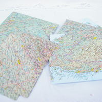 Ten handmade envelopes with from world maps