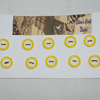 Small white and yellow buttons