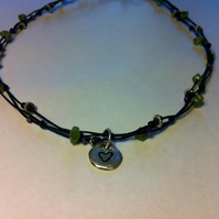 From the heart. Linen, peridot and fine silver necklace