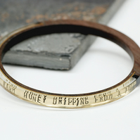 Brass, wood and resin bangle with Jungle Book stamped text