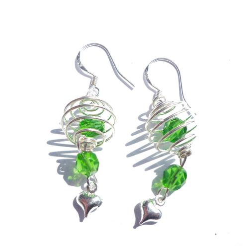 Green sparkle spiral caged earrings