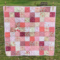 Beautiful pink handmade patchwork baby quilt playmat