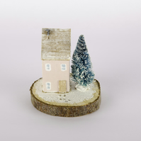 Handmade Wooden House (Pink). snow dusted log slice, brush Fir Tree & footprints