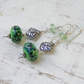 Green lampwork and bali silver glass earrings