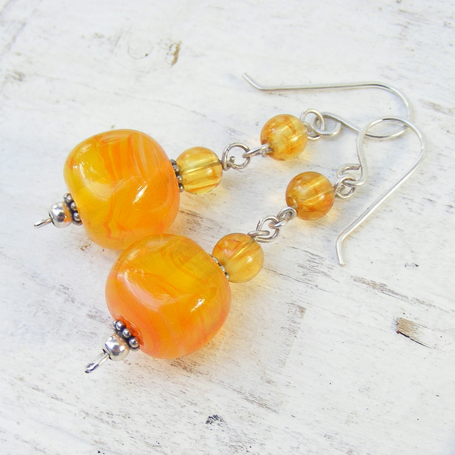 Orange lampwork, amber and silver glass earrings