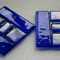 A pair of blue fused glass coasters