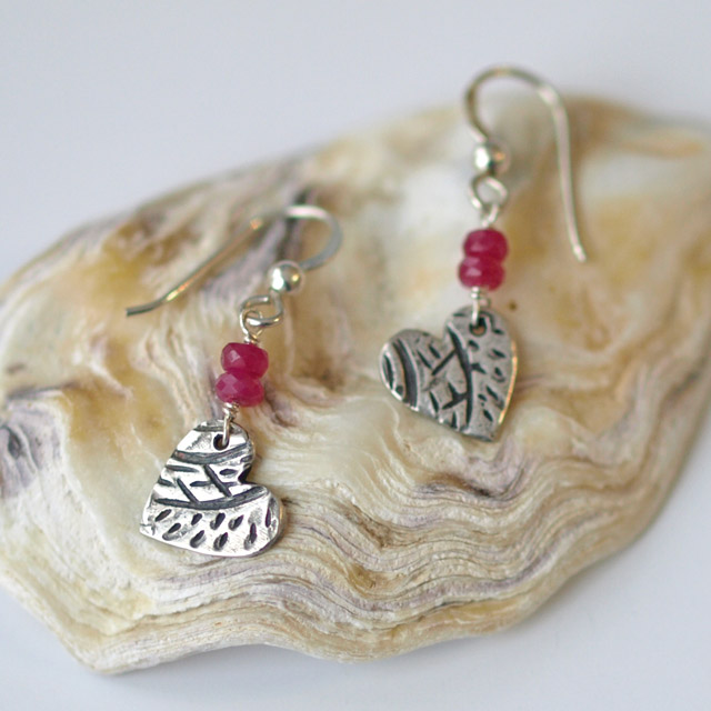 Patterned Silver Heart Earrings with Ruby Gemstones