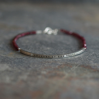 Sterling silver bar bracelet with message (written in the stars) and garnet