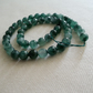 Strand of Faceted Emerald Gemstone Beads - 8mm - Mottled Green