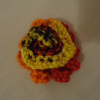 Knitted rose badge
