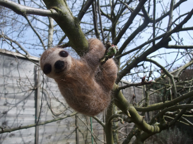 A handmade Needle felted miniature sloth