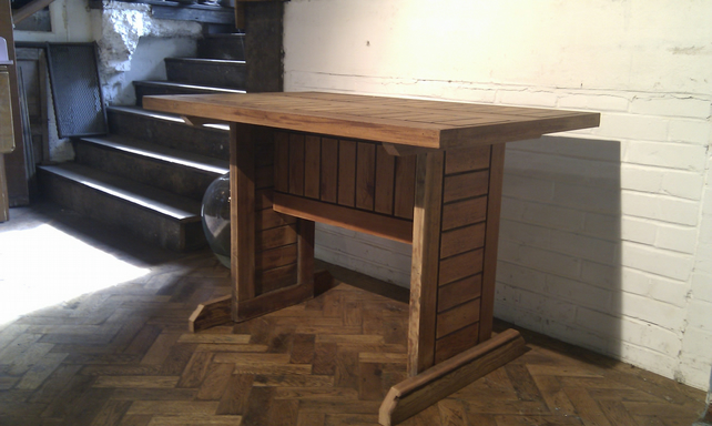 Reclaimed, upcycled table made from church pews.