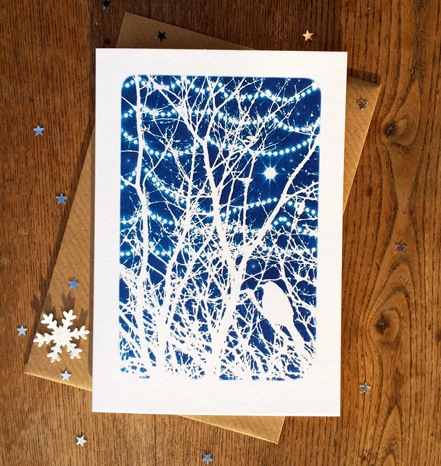 Bird in winter branches with twinkly lights card from Cyanotype image