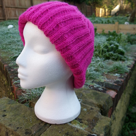 Hand knitted traditional beanie hat in deep pink