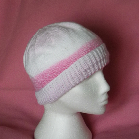 Hand knitted traditional beanie hat in pink and white 16 inch head