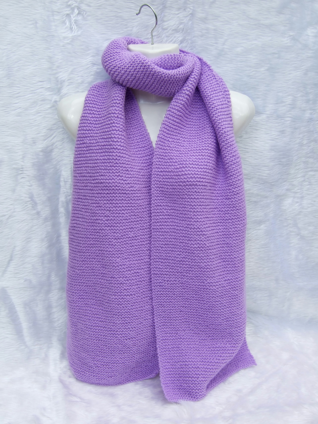 Hand knitted long and wide scarf in litmus mauve