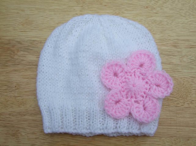 ebb955710 Hand knitted baby beanie hat in white with pink flower applique 0 - 3 months