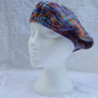 Hand knitted ladies beret style hat in orange and blue