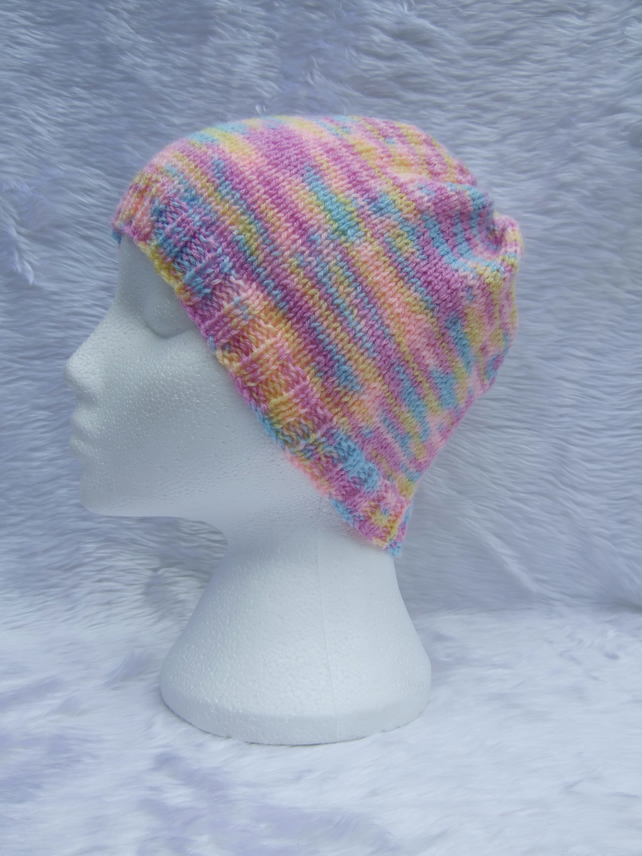 Hand knitted beanie hat in lilac blue and pink for children or teenagers