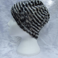 Hand knitted beanie hat in black and cream for children or teenagers