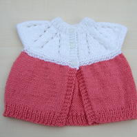 Baby sleeveless cardigan hand knitted in white and deep pink - newborn