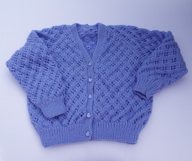 Girls cardigan hand knitted in lavender 28 inch chest  approx age 9 years