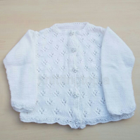 Hand knitted baby cardigan in white to fit 12 months