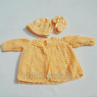 Hand knitted baby cardigan bonnet and booties to fit 12 months - peach - matinée